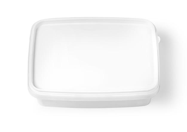 Emballage en plastique blanc isolé sur blanc avec un tracé de détourage