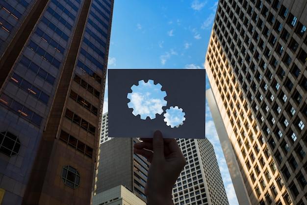 Engrenage en papier perforé pour le travail d'équipe connecté