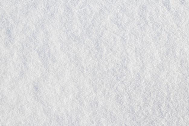 Enneigement uniforme. texture de neige sur un terrain plat