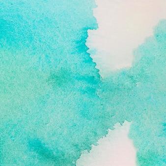 Énorme déversement de peinture turquoise
