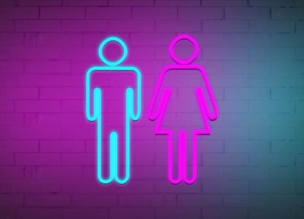 Enseignes au néon d'hommes et de femmes sur le fond d'un mur de briques.
