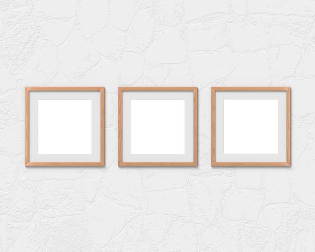 Ensemble de 3 maquettes de cadres en bois carrés avec une bordure accrochée au mur. base vide pour image ou texte. rendu 3d.