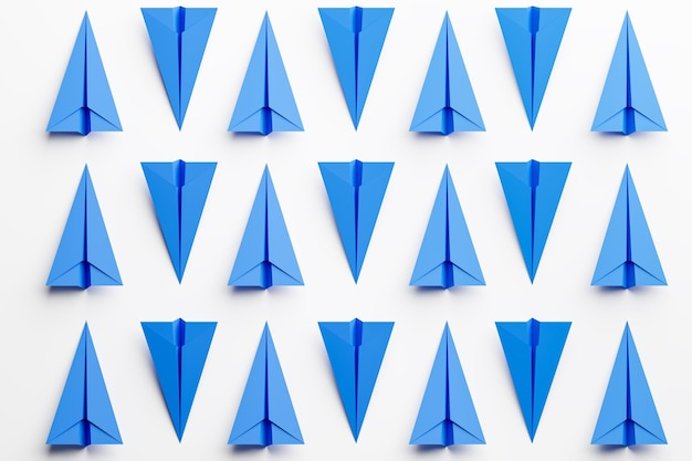 Ensemble d'avions en papier bleu sur fond blanc