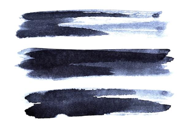 Ensemble de coups de pinceau bleu foncé isolé sur fond blanc