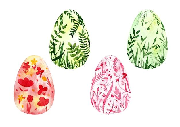 Ensemble dessiné à la main à l'aquarelle de quatre cliparts d'oeufs de pâques isolés sur fond blanc. conception botanique sur les œufs. illustrations de vacances de printemps.