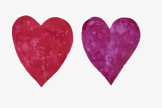 Ensemble de deux coeurs dessinés à la main dans des tons roses, rouges et jaunes, saint valentin.