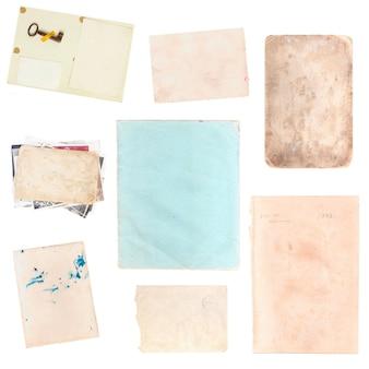 Ensemble de diverses vieilles feuilles de papier et images isolées sur fond blanc