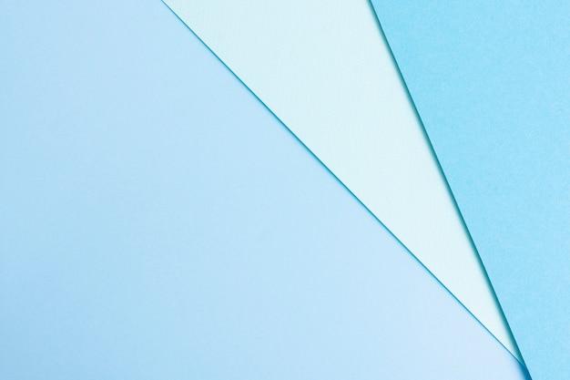 Ensemble de feuilles de papier bleu avec espace de copie