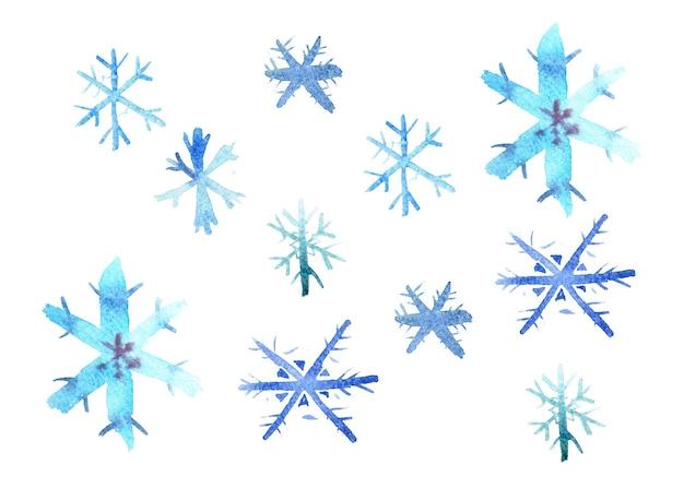 Ensemble de flocons de neige peints avec des peintures à l'aquarelle.