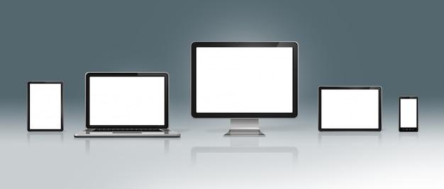 Ensemble d'ordinateurs de haute technologie sur fond gris foncé