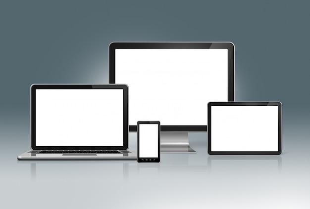 Ensemble d'ordinateurs de haute technologie sur un gris futuriste