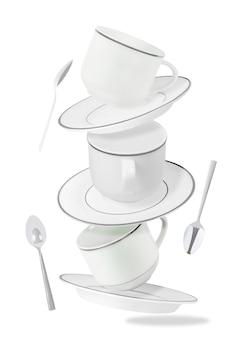 Ensemble de tasses à thé ou à café volantes, assiettes et cuillères isolées