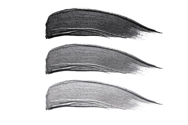 Ensemble de traits d'échantillons cosmétiques, trait métallique noir et gris