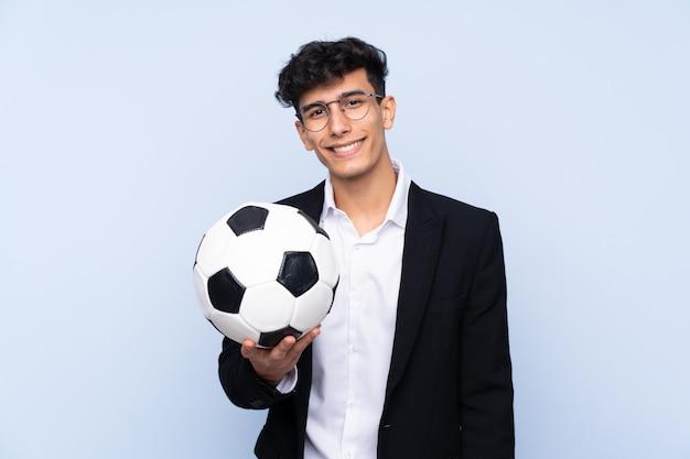 Entraîneur de football homme sur mur isolé