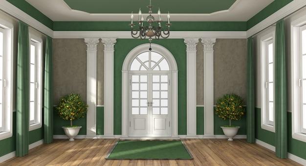 Entrée de maison verte et brune d'une villa de luxe