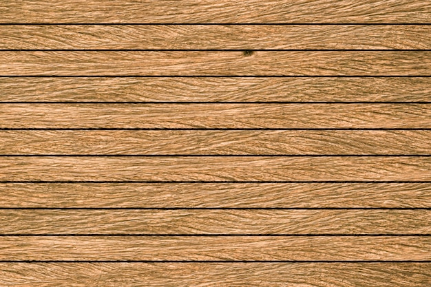 Épluchage vintage de texture de fond en bois brun jaune âgé.