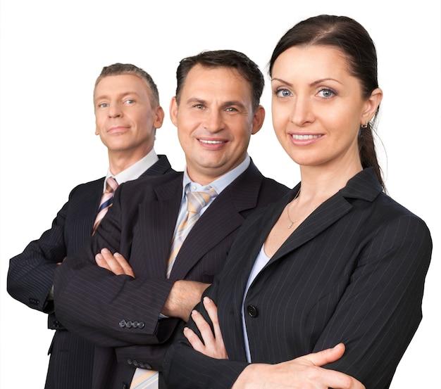 Équipe de gens d'affaires adultes avec les mains croisées sur fond