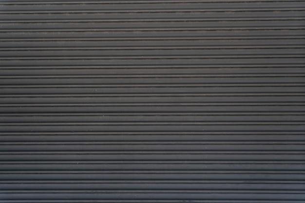 Espace de copie de rayures horizontales de mur en acier abstrait