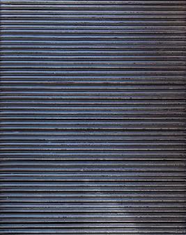 Espace de copie de rayures verticales de mur en acier abstrait