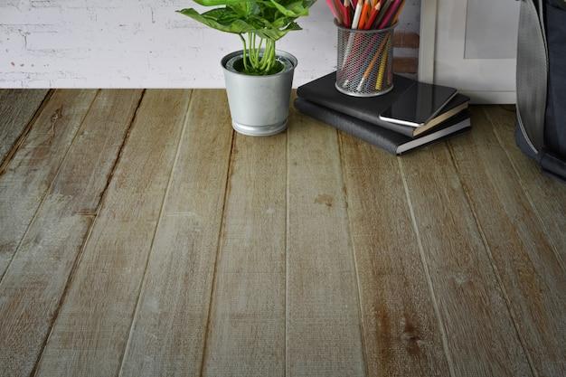 Espace de travail en bois créatif avec fournitures de bureau et espace de copie.