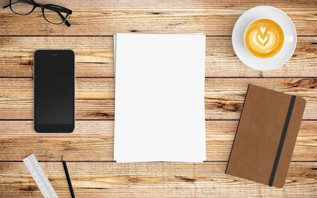 Espace de travail moderne avec une tasse à café, du papier, un bloc-notes et une tablette.