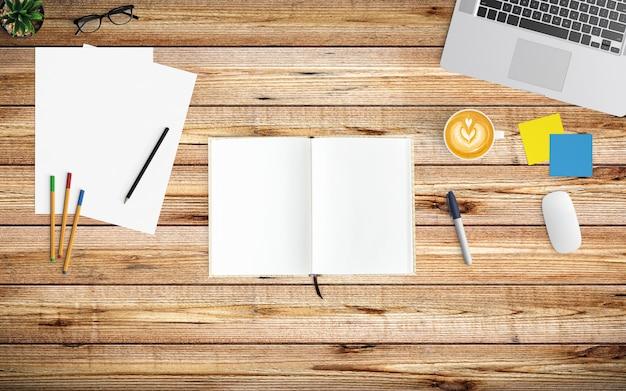 Espace de travail moderne avec tasse à café, papier, ordinateur portable, tablette ou smartphone et ordinateur portable sur bois