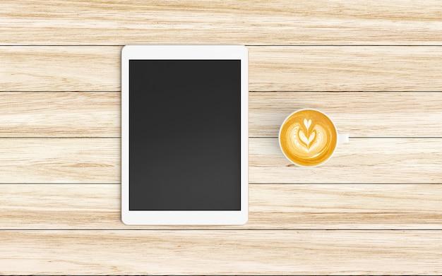 Espace de travail moderne avec tasse à café et tablette ou smartphone sur bois
