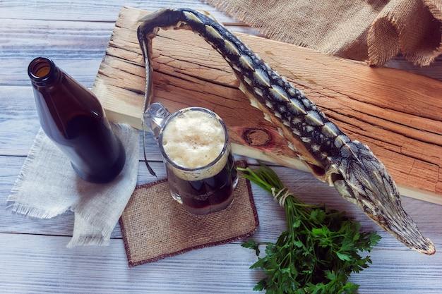 Esturgeon séché avec bière brune et légumes verts
