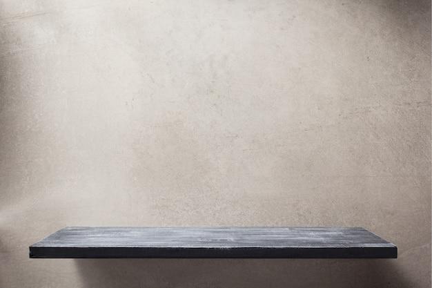 Étagère en bois et texture de fond de mur gris
