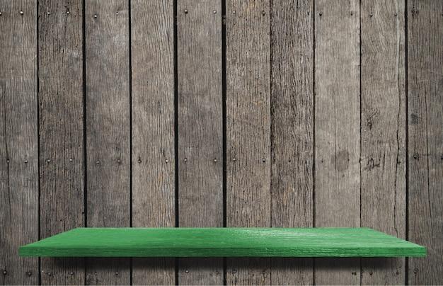 Étagère en bois vert pour l'affichage des produits