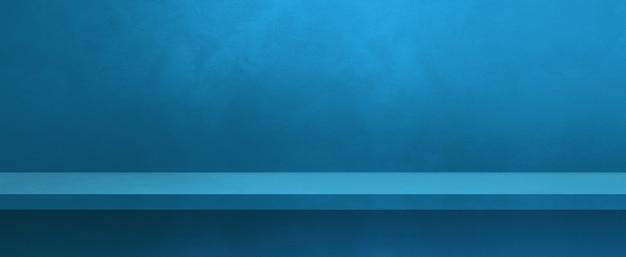 Étagère vide sur un mur bleu. scène de modèle d'arrière-plan. bannière horizontale