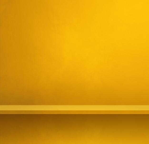 Étagère vide sur un mur jaune. scène de modèle d'arrière-plan. bannière carrée