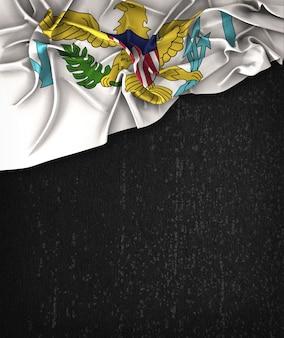 États-unis virgin islands flag vintage sur un tableau noir grunge avec un espace pour le texte