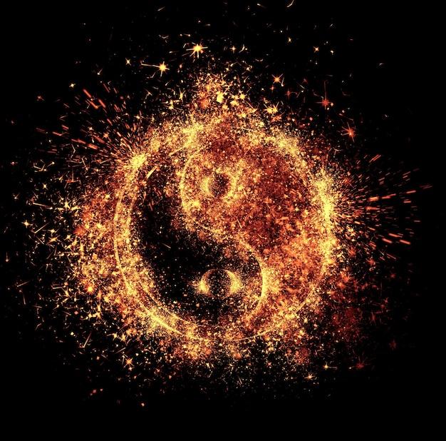L'étincelle yin et yang est isolée sur fond noir