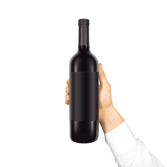 Étiquette noire vierge sur une bouteille de vin rouge