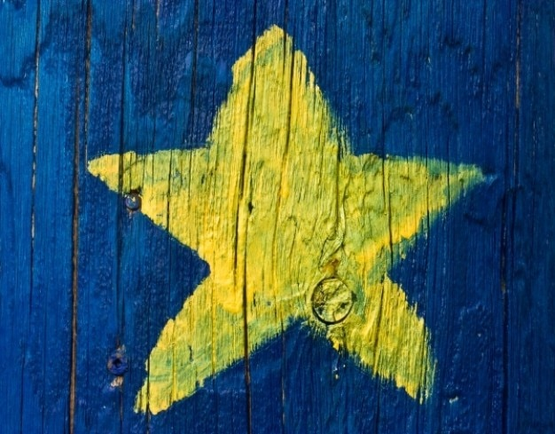 Étoile acadienne peint sur bois