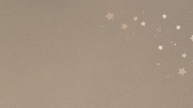 Étoiles dorées chatoyantes sur fond beige