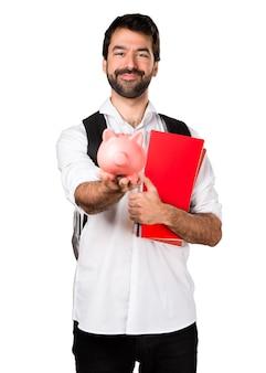 Étudiant, homme, tenue, piggybank