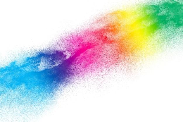 Explosion de particules multicolores sur fond blanc.