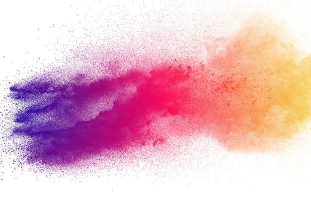 Explosion de poudre colorée. éclaboussures de particules de poussière de couleur pastel abstraite.
