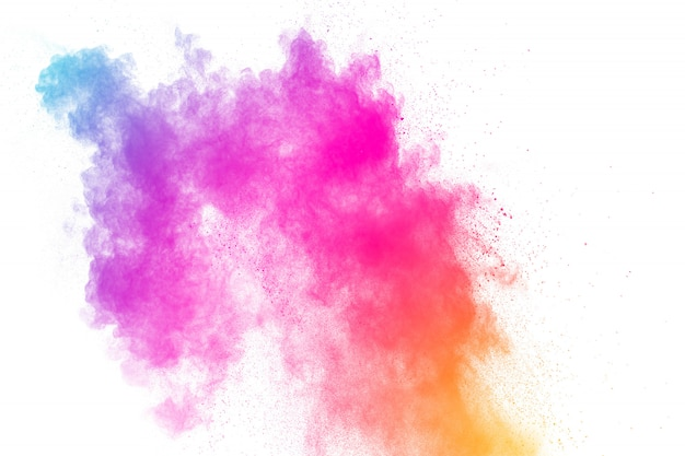 Explosion de poudre colorée. éclaboussures de particules de poussière de couleur pastel.