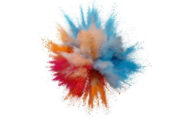 Explosion de poudre colorée sur fond blanc. gros plan abstrait poussière sur toile de fond. explosion colorée. peinture holi