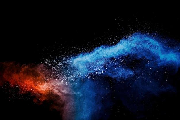 Explosion de poudre de couleur orange bleu