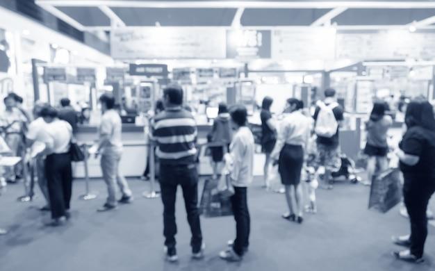 Exposition abstraite événement floue avec fond de personnes, concept de spectacle de convention d'affaires