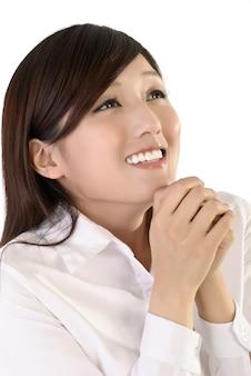 Expression de femme d'affaires de rêve, portrait agrandi de dame de bureau oriental.