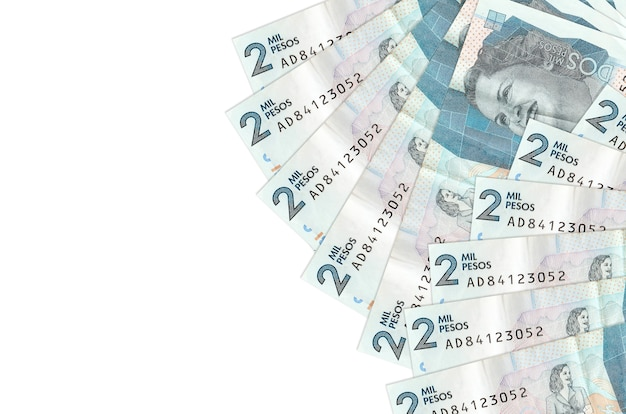 Factures de pesos colombiens portant sur une surface blanche