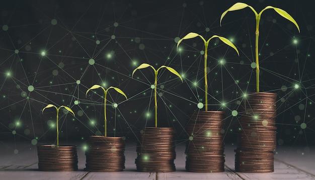 Faire croître l'argent, financer les entreprises et économiser de l'argent, graphe croissant de la pile de pièces d'argent, plante qui grandit sur des pièces. équilibrer l'épargne et l'illustration des investissements