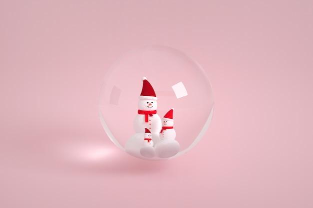 Famille de bonhomme de neige dans une bulle de verre
