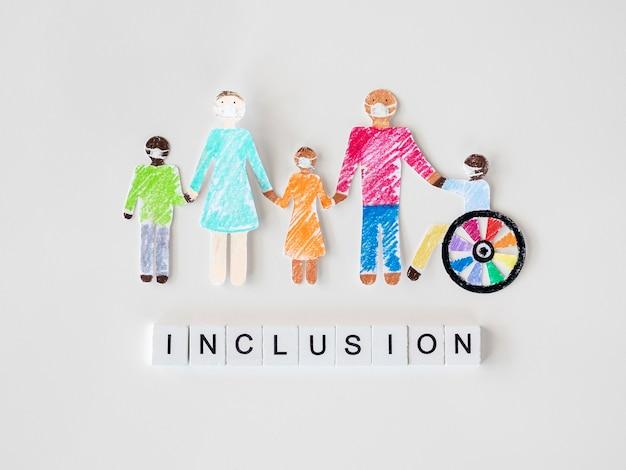 Famille avec personne handicapée dans le concept d'inclusion de papier découpé