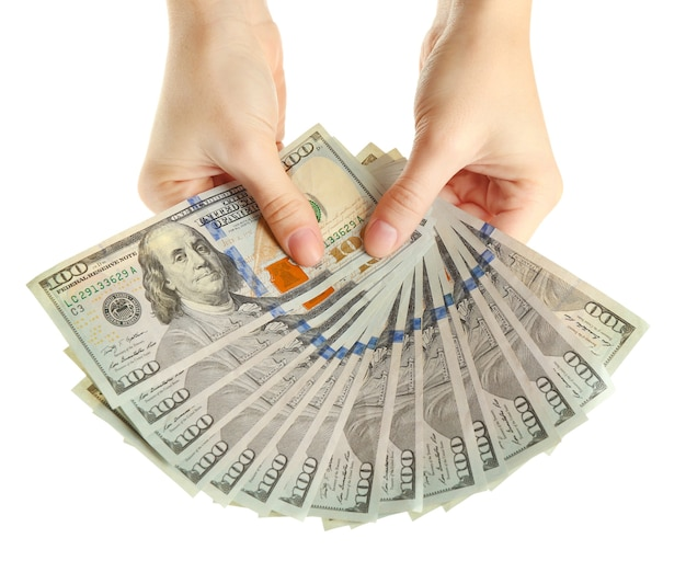 Fan d'argent entre les mains des femmes sur blanc